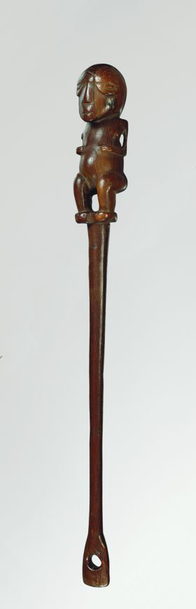 Flywhisk handle made of ironwood, with the lower part shaped like a human figure and the upper part consisting of a spoon-like form.