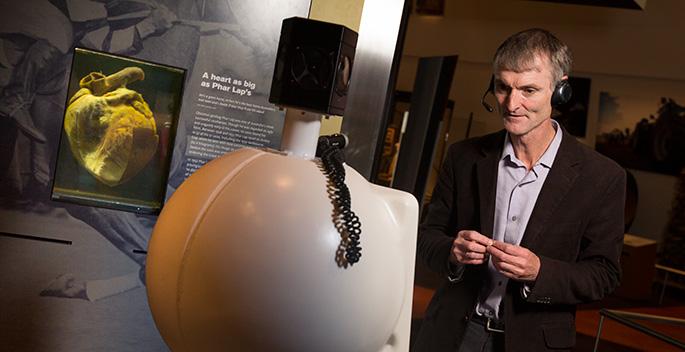 Robert Bunzli with a Museum robot.