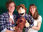 Two people holding puppets