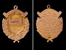 The front and back of a medal awarded to Vince Kelly.  The front has an image of the Sydney Harbour Bridge with an inscription that reads: 'From L. Ennis. O.B.E. Director of Construction'. The inscription on the back reads: 'To Vincent R. Kelly. To mark his preservation from serious injury on falling into the harbour. A distance of 182 feet. 23rd. Oct. 1930.'