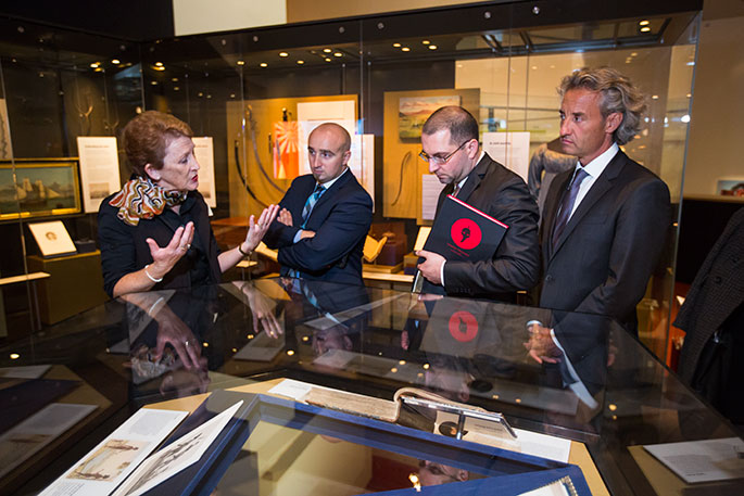 Museum host Linda Puckett taking French officials on a tour of the Museum