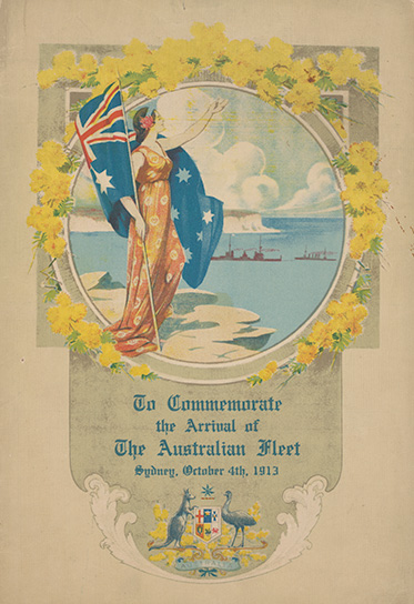 Woman standing on the south headland of Sydney Harbour watching the arrival of the Australian naval fleet. The woman is holding an Australian flag and is framed by a circular border surrounded by wattle. Printed text at bottom reads 'To Commemorate / the Arrival of / The Australian Fleet / Sydney, October 4th, 1913'. The Australian coat of arms is printed below.