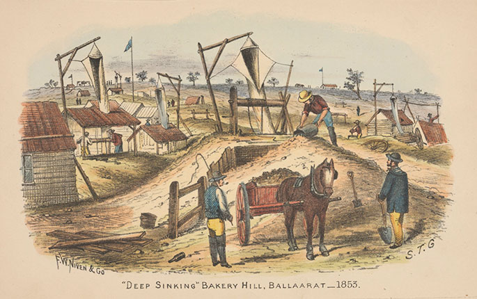 A series of huts with gerry-rigged frames from which are suspended what appear to be canvas chutes extending down into holes in the ground. In the foreground three men are working around a pony and cart, which is filled with soil.
