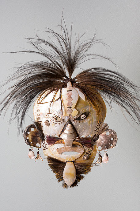 Cultural mask with white and brown tones and feathers for hair - click to view larger image
