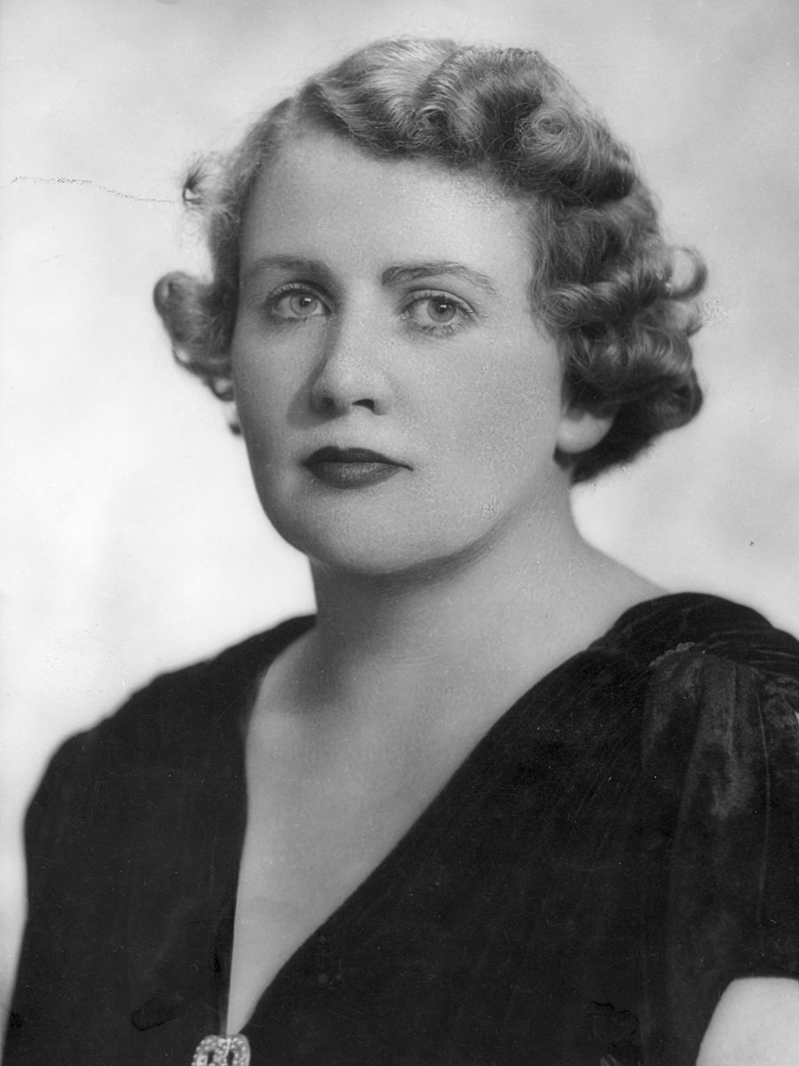 Black and white photo of Dorothy Tangney looking straight at camera. - click to view larger image