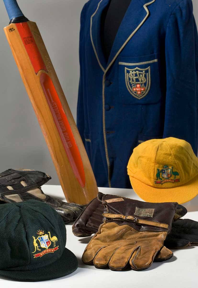 Cricket bat, blue blazer, caps and gloves. - click to view larger image