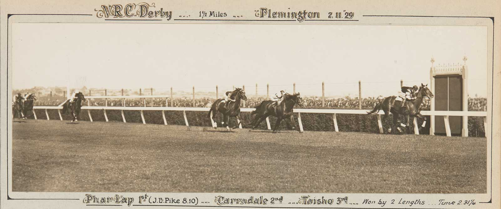 A black and white photo of Phar Lap winning the VRC Derby, 1929. - click to view larger image