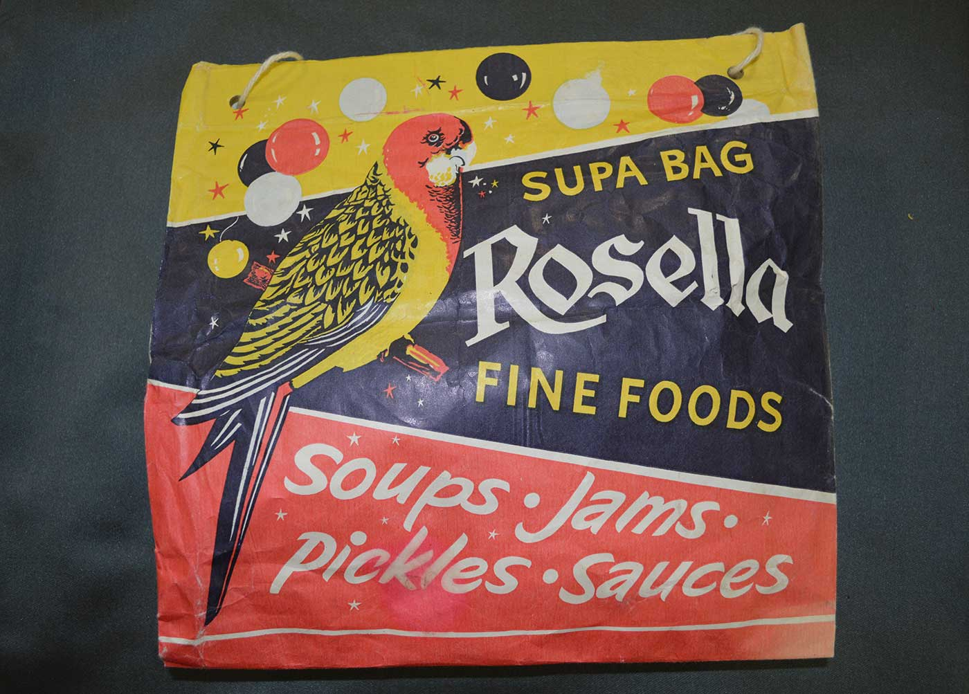 Colour photograph of a show bag with printed text 'Supa Bag, Rosella Fine Foods, Soups, Jams, Pickles, Sauces'. - click to view larger image