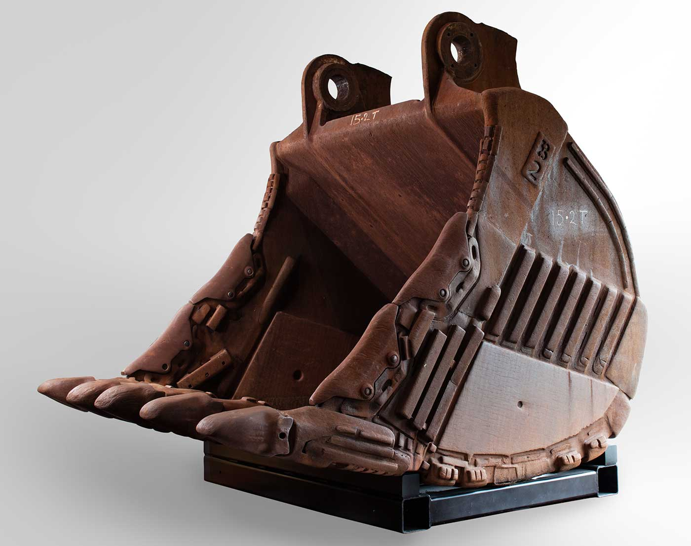 A rusty, concave-shaped iron bucket from a mining excavator.  - click to view larger image