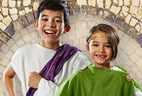 Two children dress in Roman costume