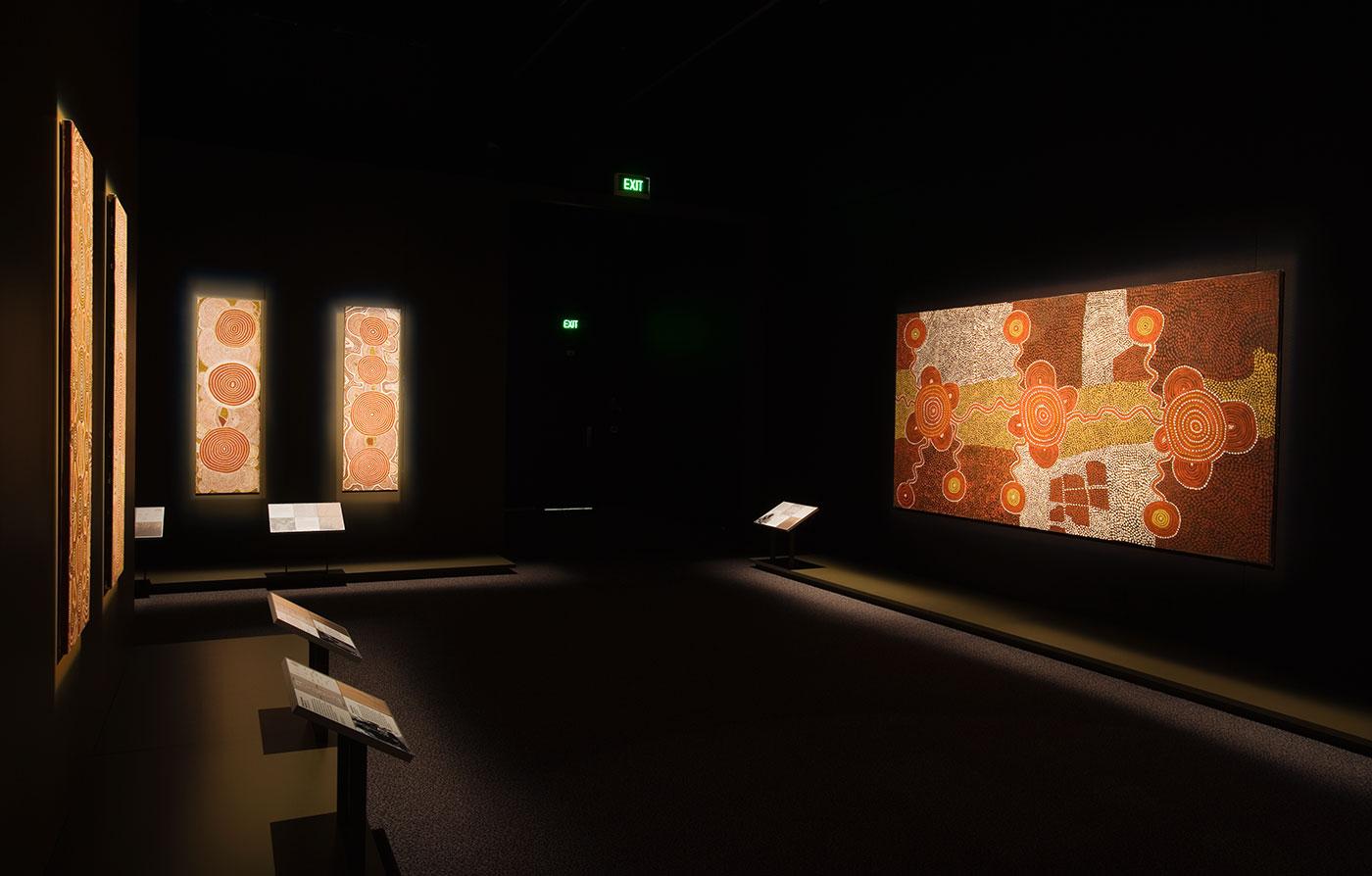 Long gallery shot showing 'Yumari' 1976 dot painting. - click to view larger image