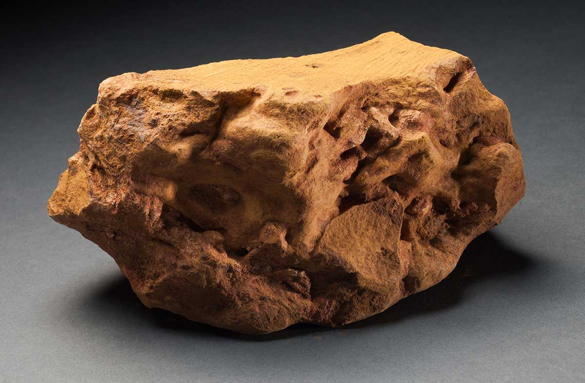 Rock with ochre colour and rough surface. - click to view larger image