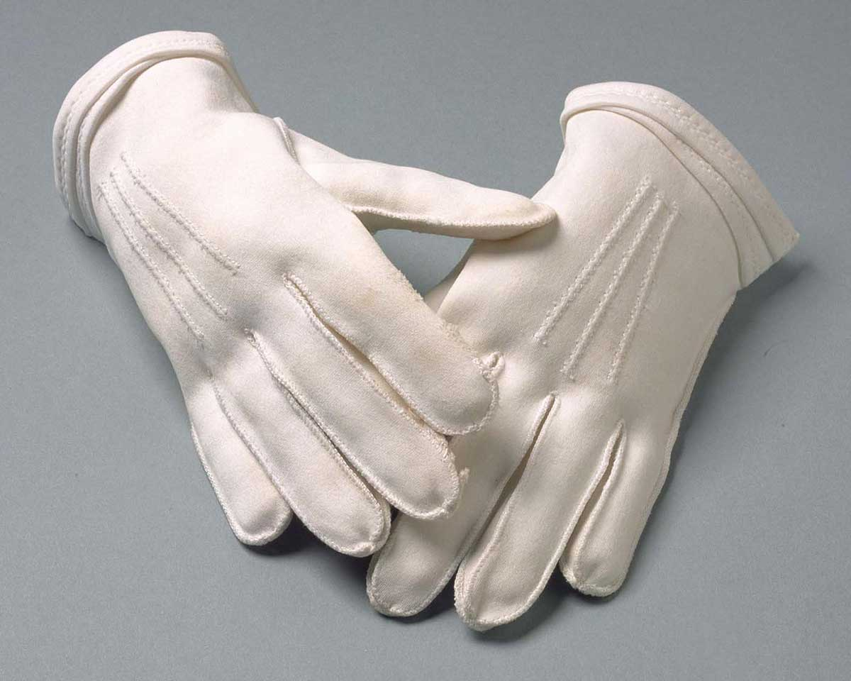A pair of ladies' short white gloves. - click to view larger image