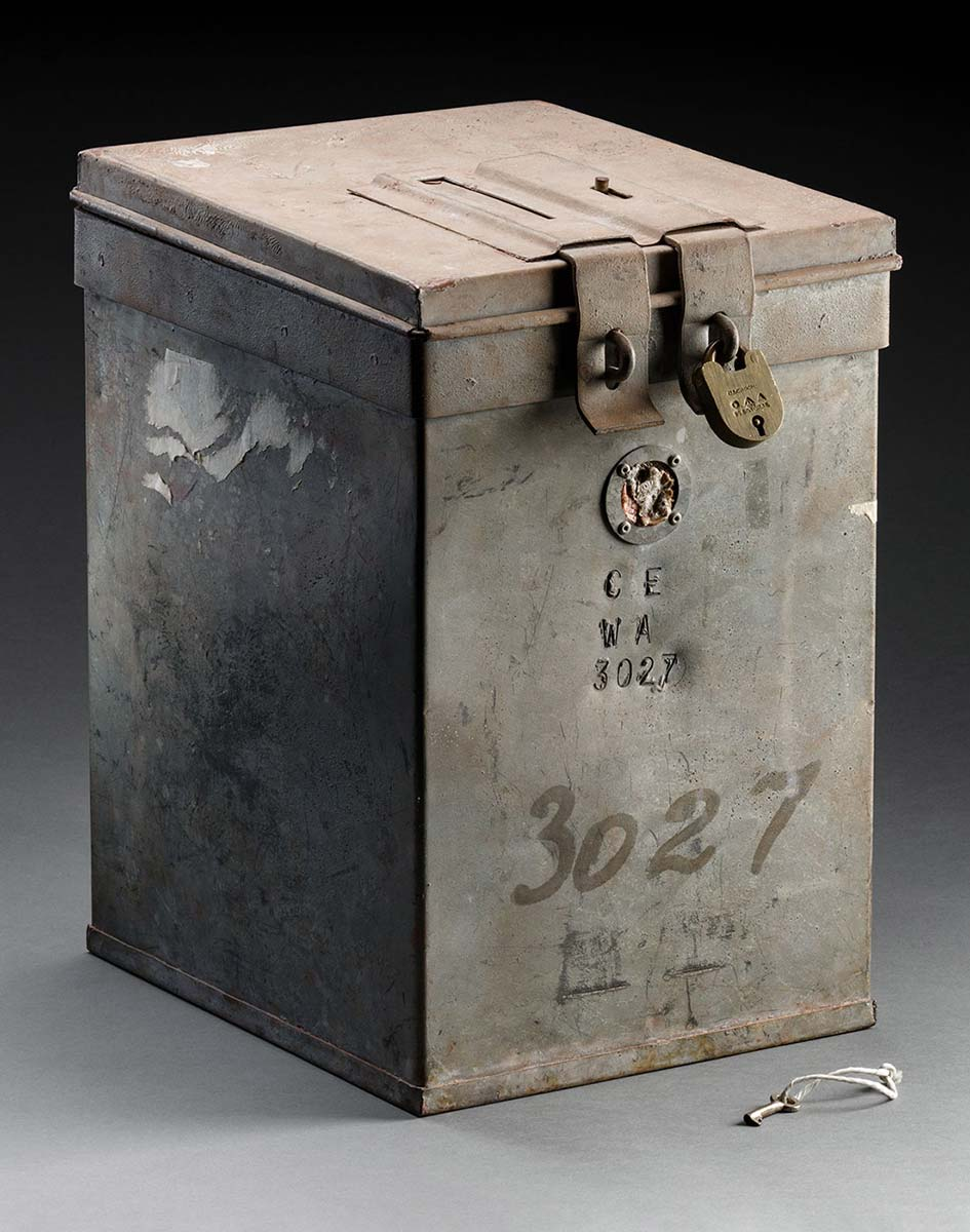 A rectangular, galvanised metal voting box with a hinged lid. The text 'CE WA 3027' is on the front of the box and the number '3027' is repeated in black marker. - click to view larger image