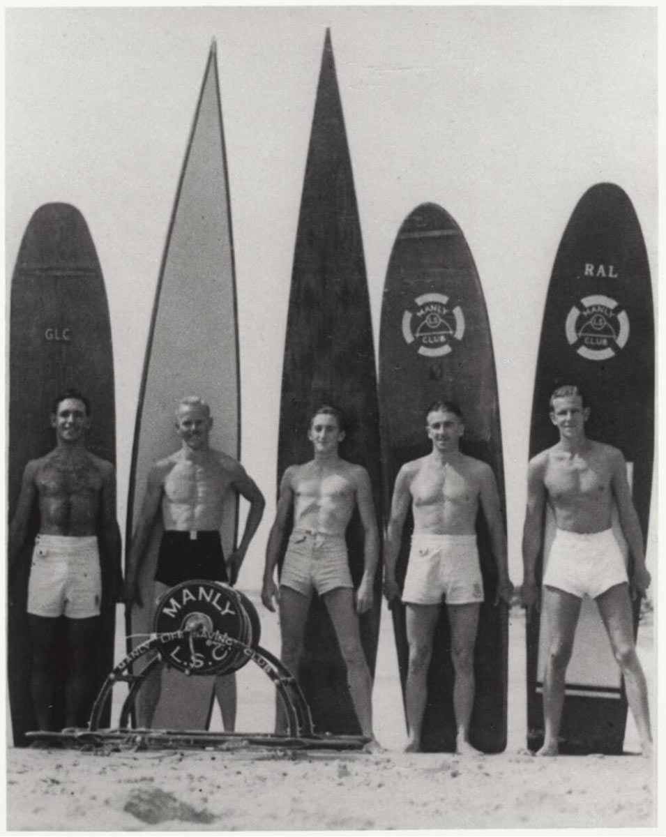 Five men and their surfboards at Manly Beach, New South Wales, 1938-1946. - click to view larger image