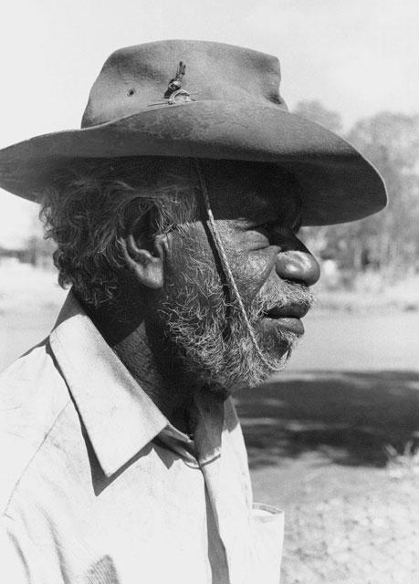 Portrait photo of an Aboriginal Australian man.