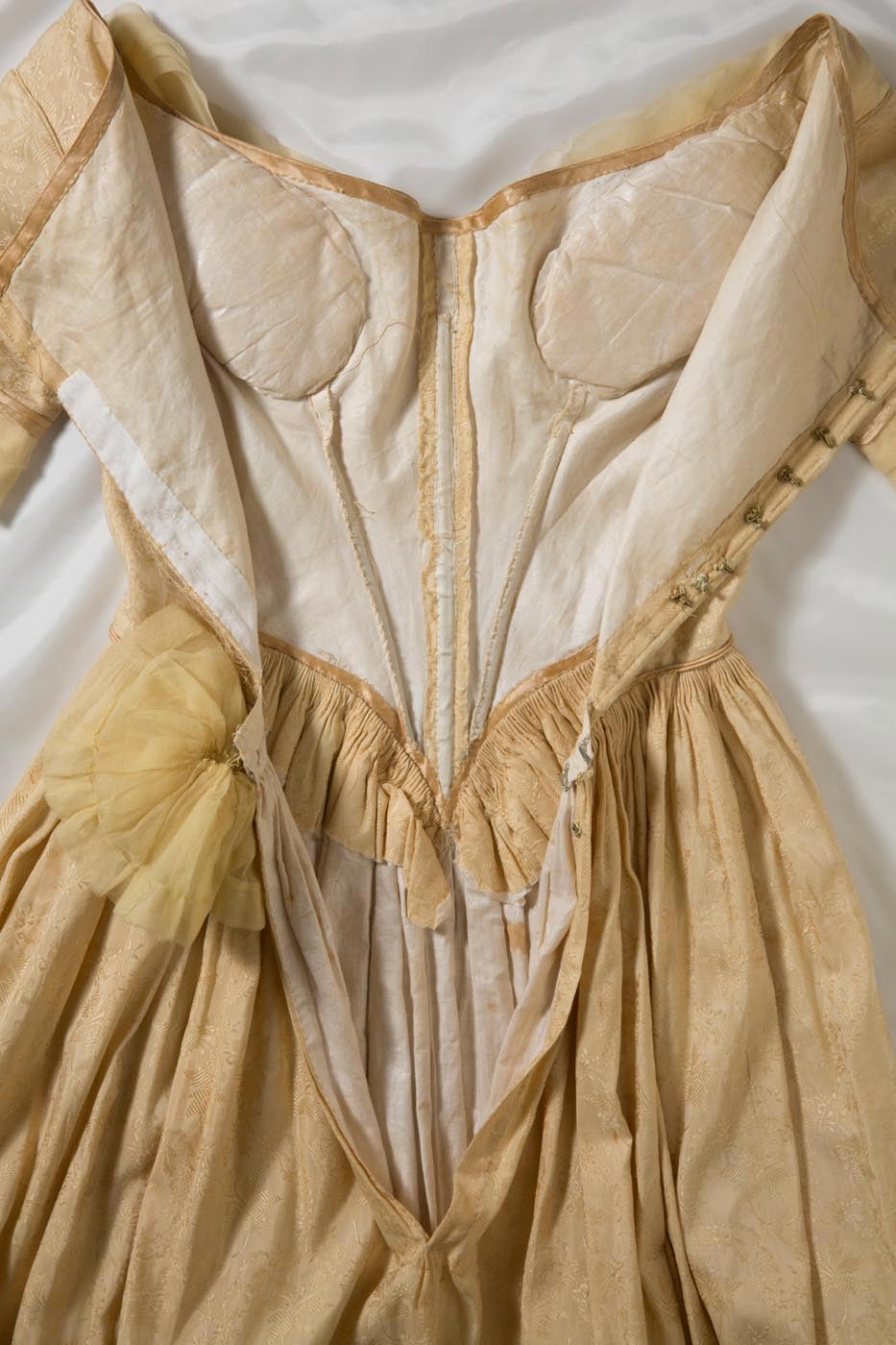 The interior of the bodice showing the lining and boning. - click to view larger image