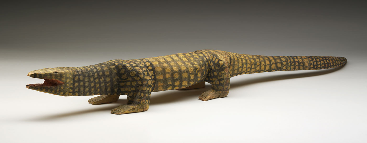 Wooden sculpture of a goanna.