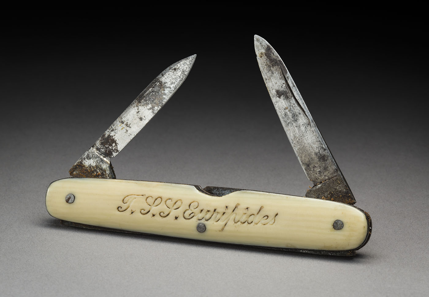 A miniature bone-handled pocket-knife inscribed 'T.S.S. Euripides' on one side.