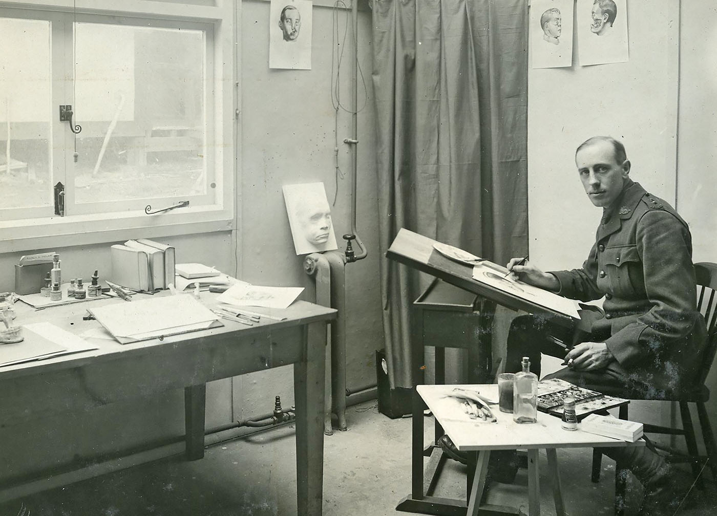 Portrait of a man sitting in his artist's studio.