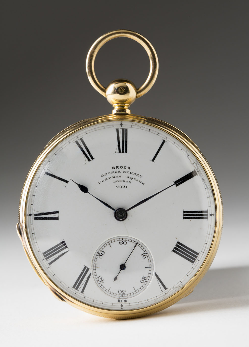 A gold pocket watch with roman numerals and text 'Brock, George Sydney' - click to view larger image