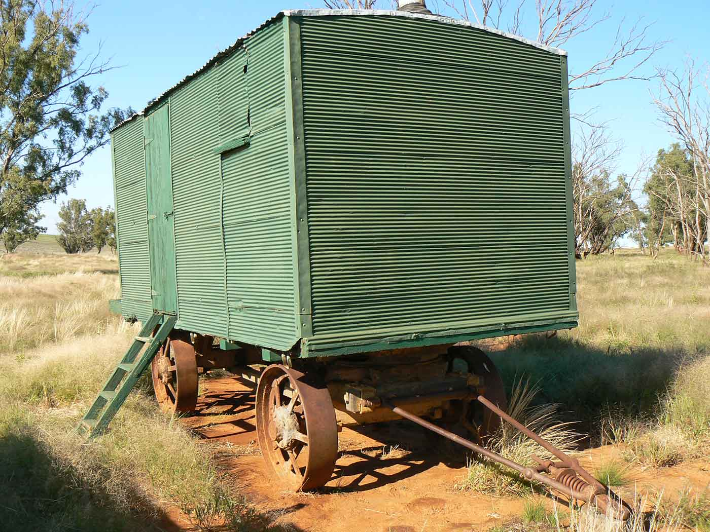 A cook's galley in the form of a metal-clad, timber and iron-framed box raised on wagon wheels.