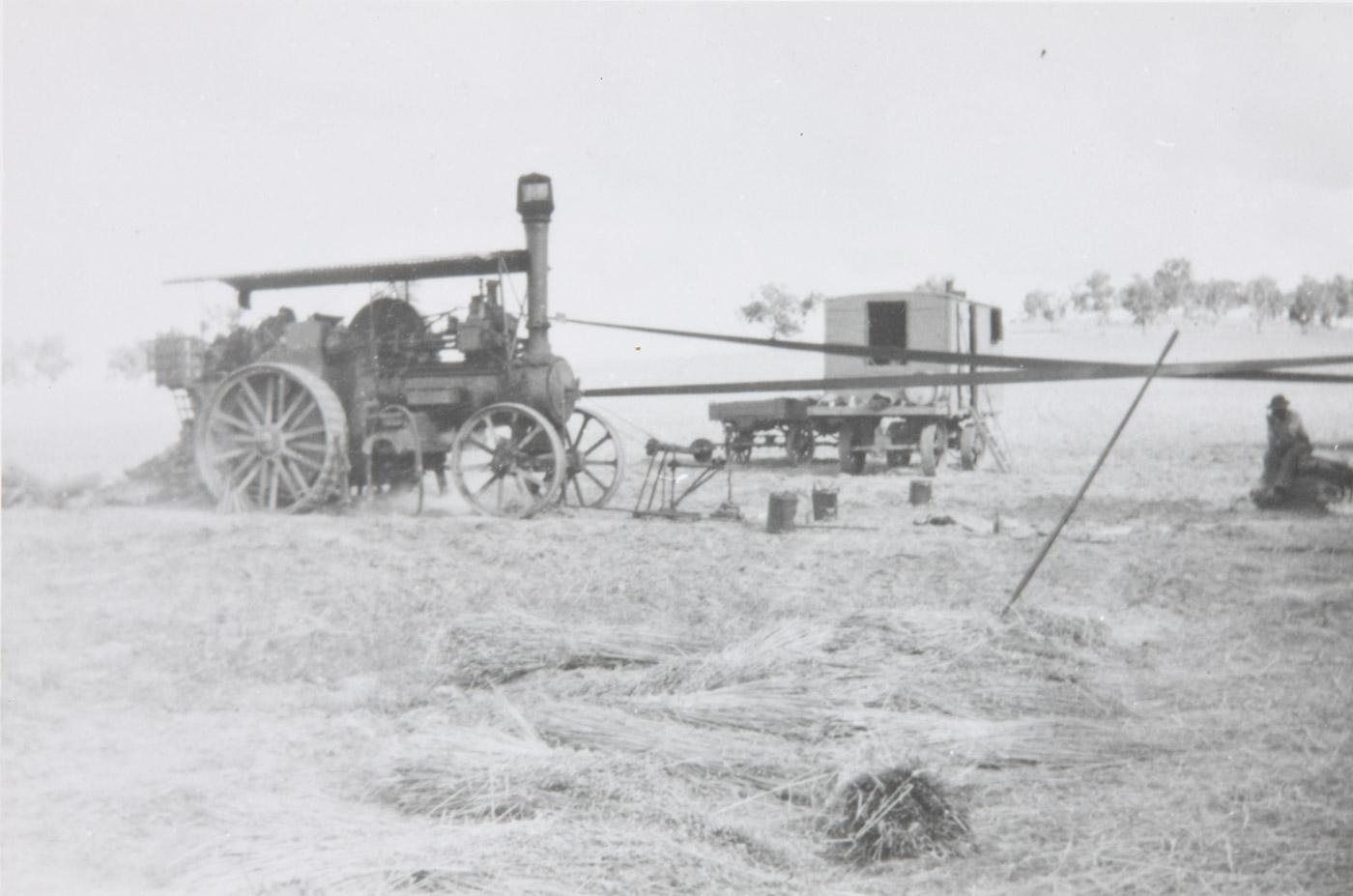 On the right Dick Earl resting on bags, with galley in the centre rear and the chaff cutting plant on the left. - click to view larger image