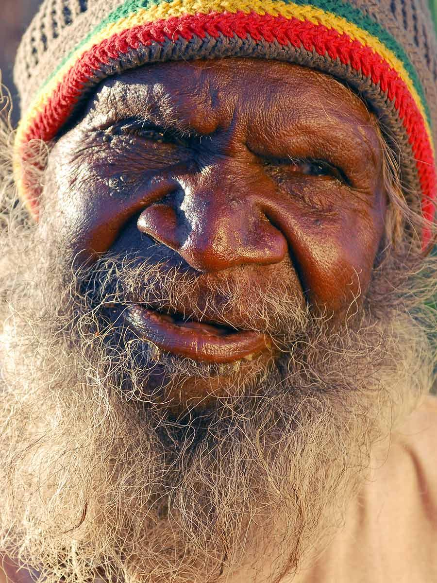 Portrait of Charlie Wallabi (Walapayi) Tjungurrayi. - click to view larger image