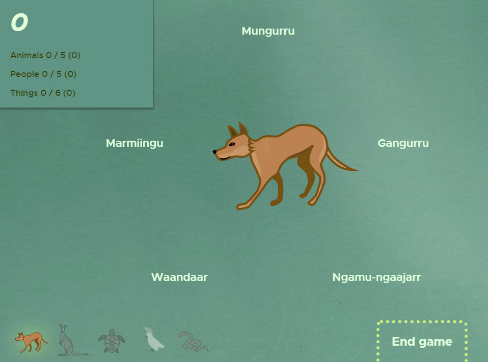 Screenshot of a digital game featuring a dingo surrounded by words in the Aboriginal language Guugu Yimidhirr.