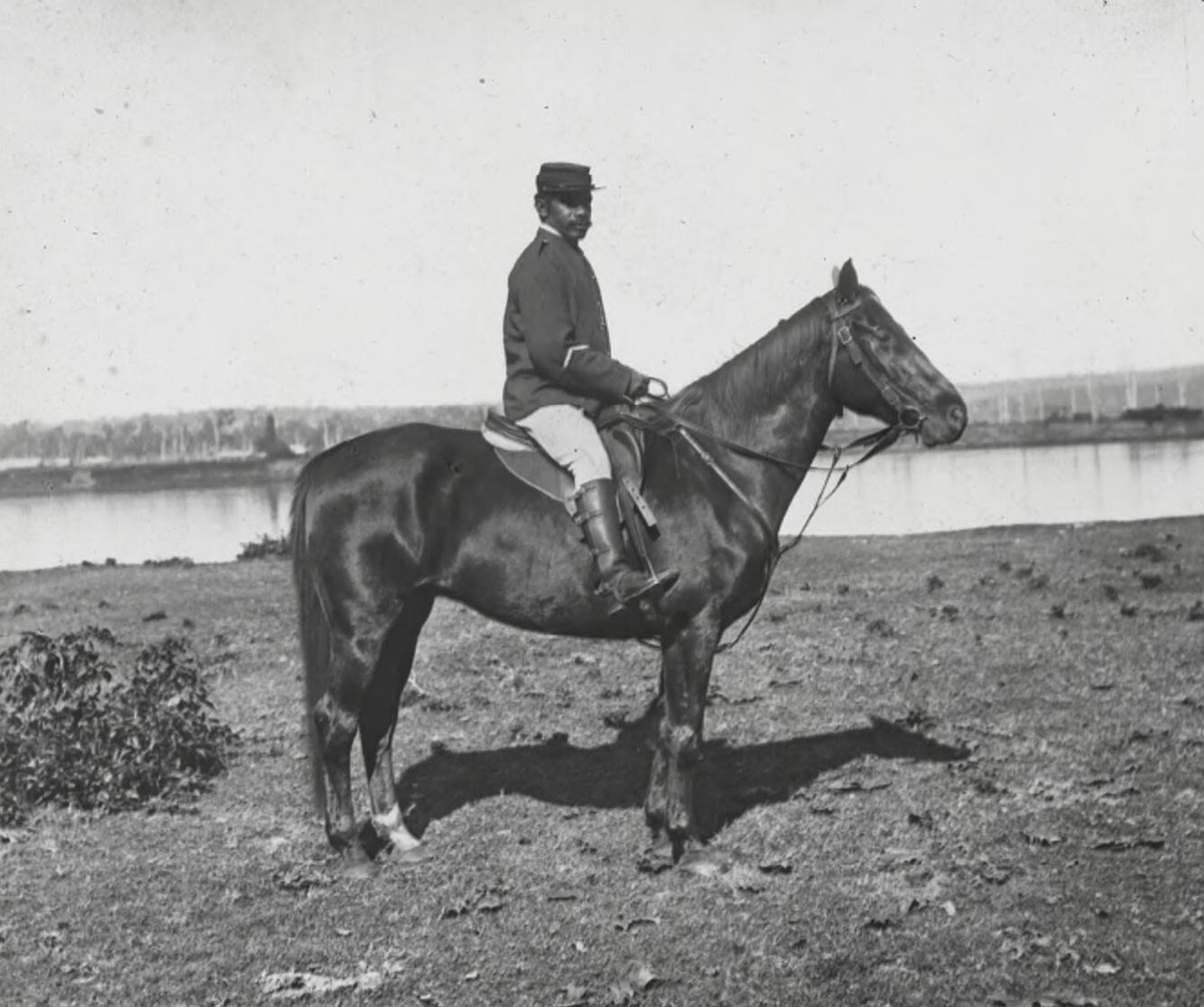 Black and white photograph of a policeman on horseback.