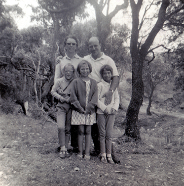 A black and white photograph of the Pollak family in a bush setting. - click to view larger image