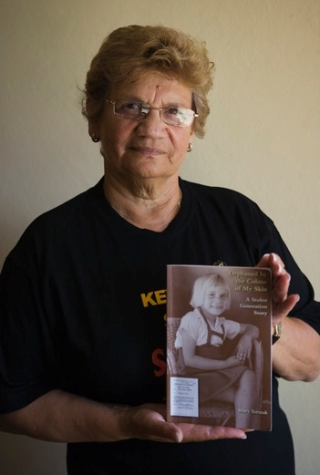 Mary Terszak holding a copy of her book Orphaned by the Colour of My Skin: A Stolen Generation Story. - click to view larger image