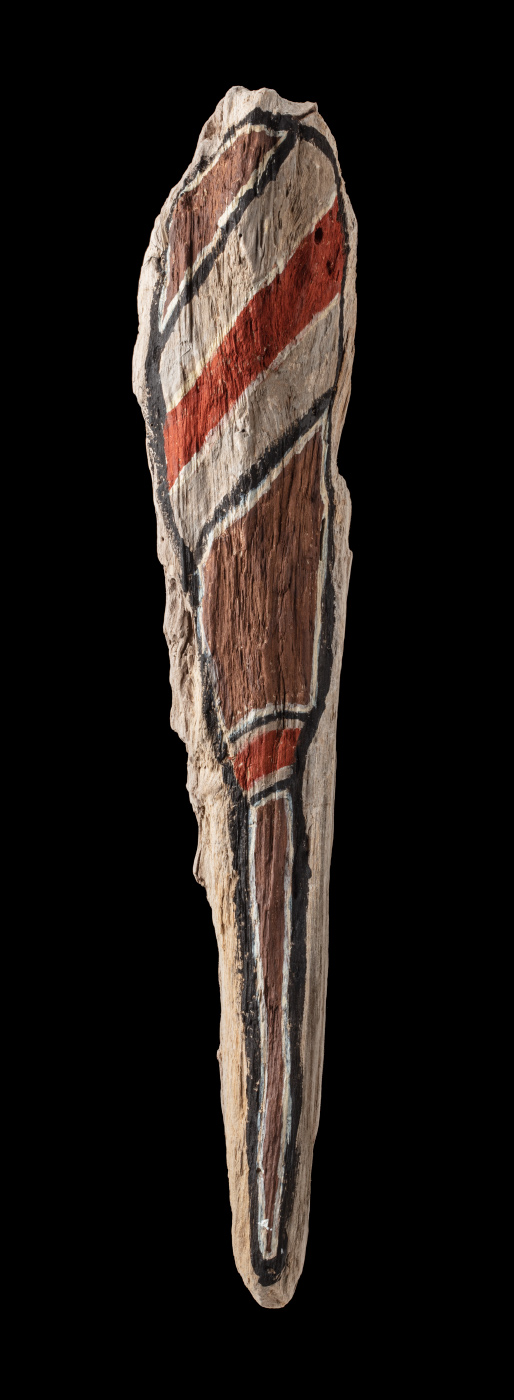 An acrylic painting on driftwood featuring brown, red, grey, white and black diagonal lines from one end towards the middle and a brown vertical line at the other end. - click to view larger image