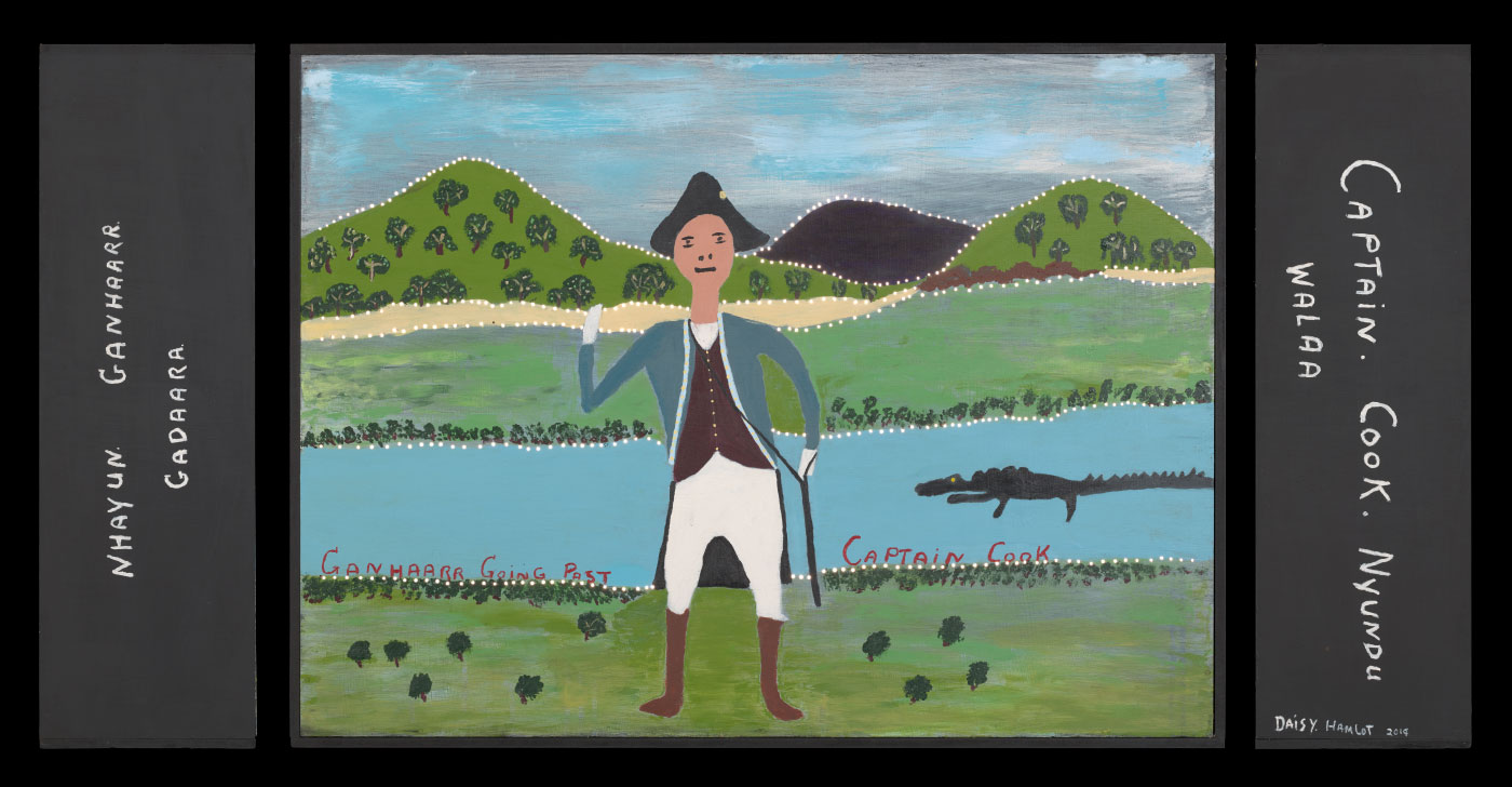 A plywood and medium density fibreboard [MDF] lightbox with a painting in acrylic on the front of captain Cook standing in front of a river that has a crocodile in it. There are hills in the background. Hand painted text in the river reads 'GANHAARR GOING PAST CAPTAIN COOK'. Text on the right side of the box reads 'CAPTAIN . COOK. NYUNDU / WALAA'. Text on the left side reads 'NHAYUN GANHAARR / GADAARA'. Text on the back reads 'Hopevale Arts + Culture / Daisy Hamlot / 205/19'. There are very small holes drilled into the painting along the river and the background. - click to view larger image
