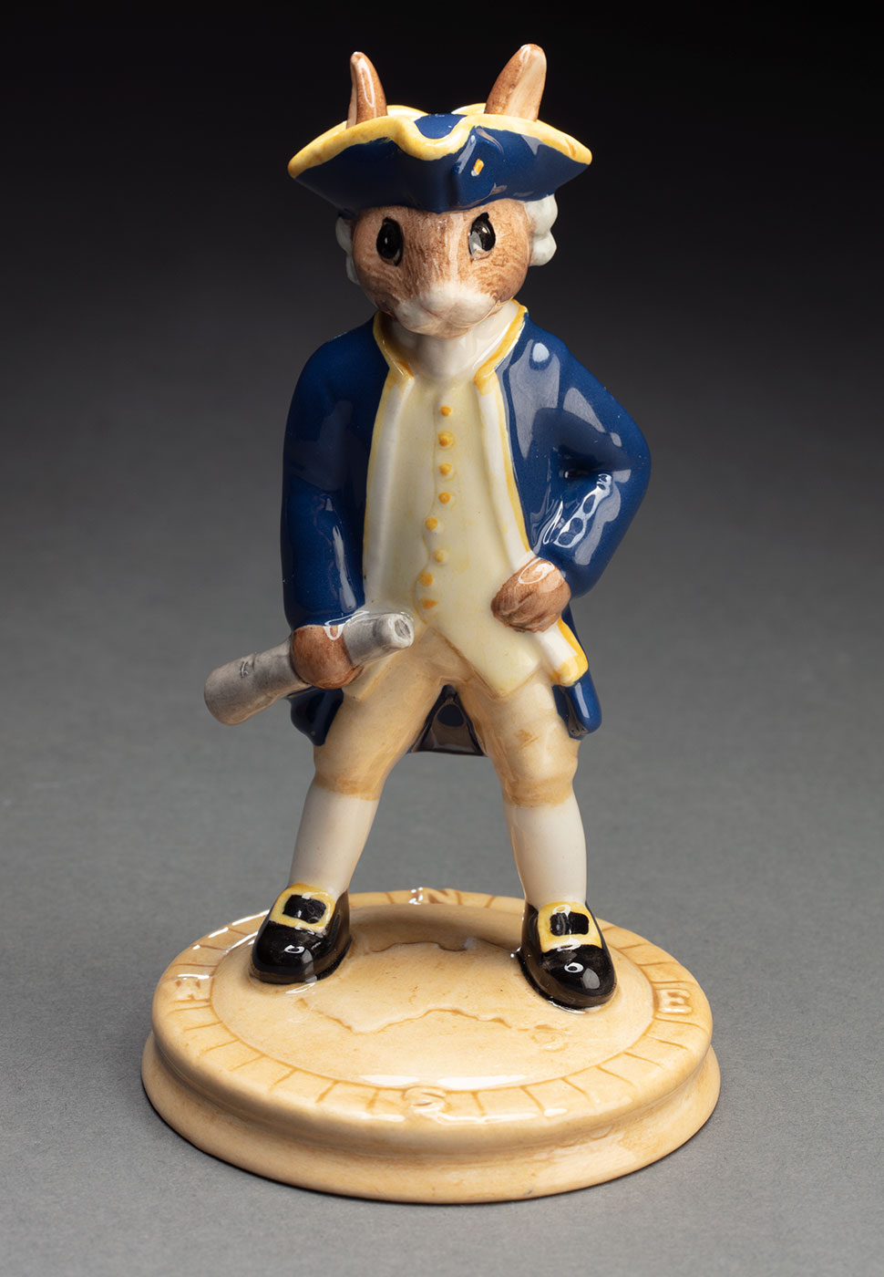 Ceramic figurine of a rabbit with the body of a human wearing period clothing. - click to view larger image