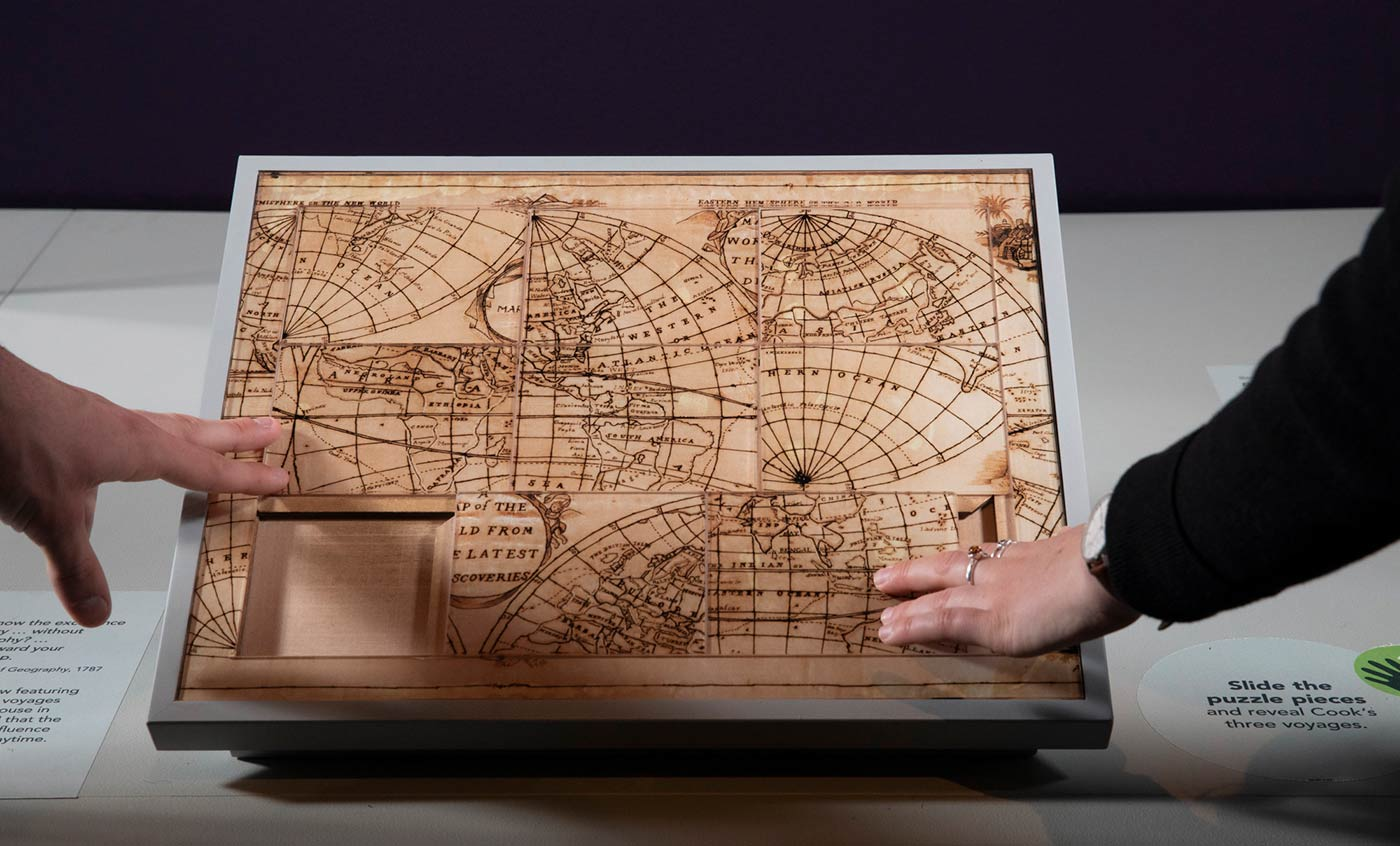 Jigsaw of a map on display in an exhibition space. - click to view larger image