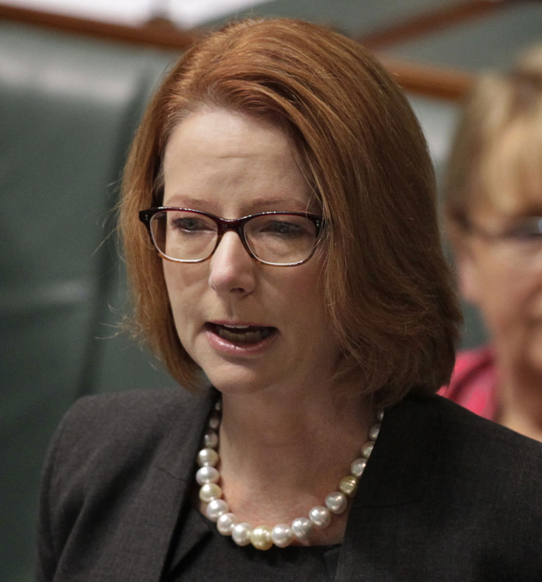 Julia Gillard who appears quite emotional addresses the chamber at Parliament House. - click to view larger image