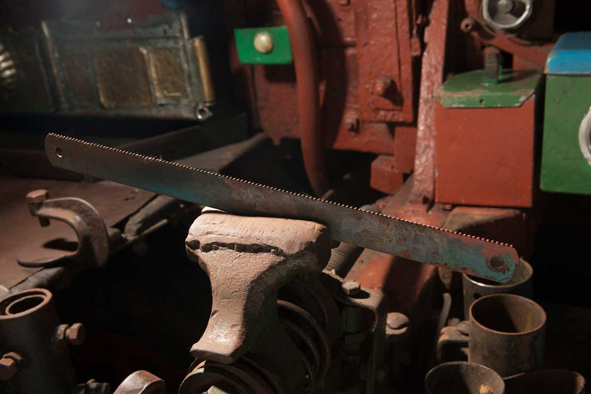 An old saw in a clamp. - click to view larger image