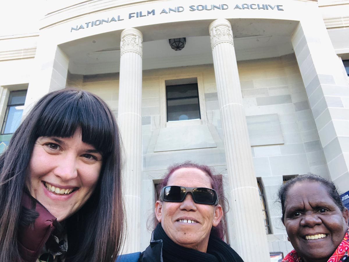 Group shot of three women standing out the front of the National Film and Sound Archive. - click to view larger image