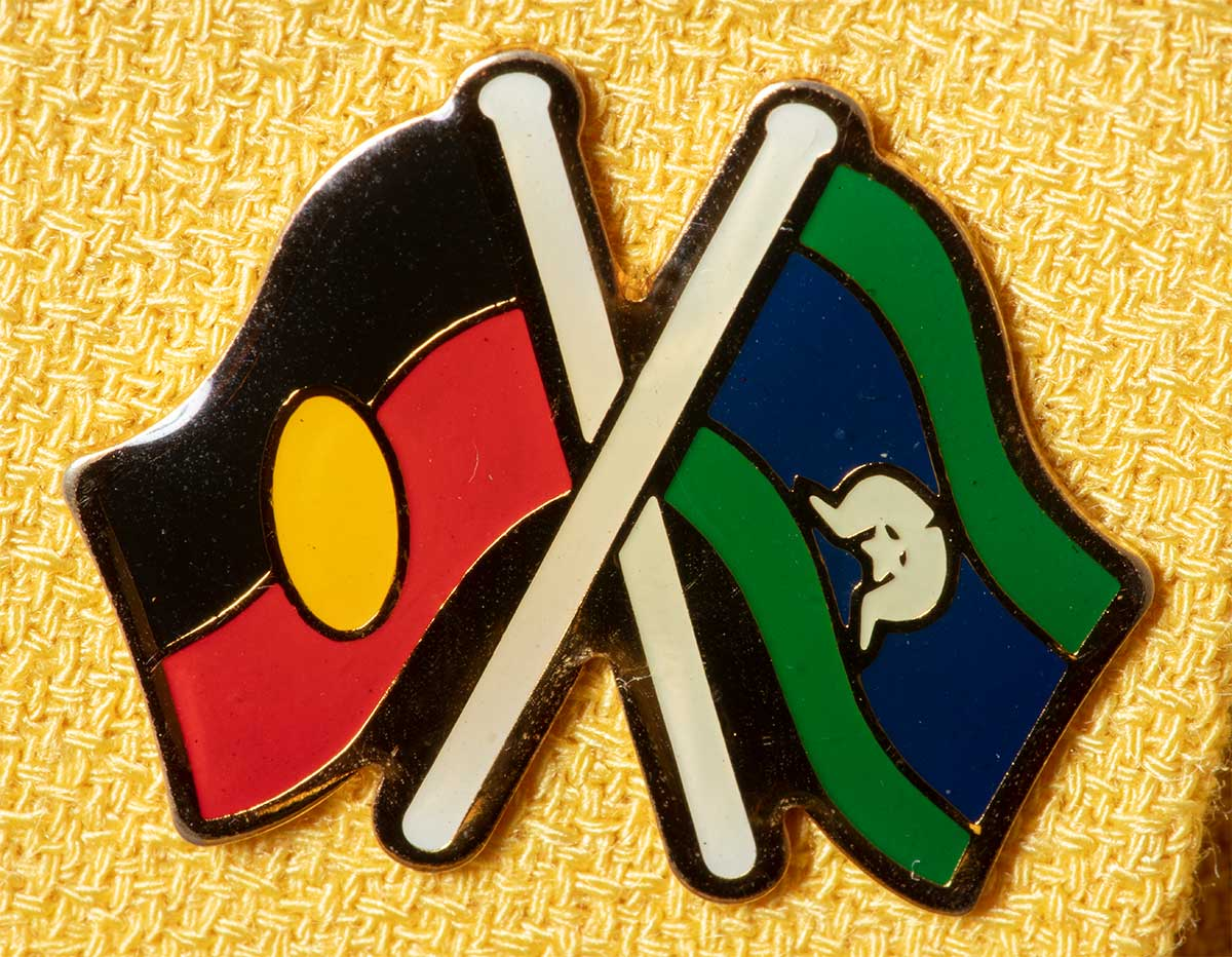 Pin featuring the Aboriginal and Torres Strait Islander flags. - click to view larger image