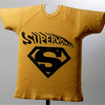 Thumbnail image of a yellow T-shirt with a Superwoman icon on the front