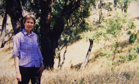 Diana Boyer at the Bobbara Creek Travelling Stock Reserve, a rare and diverse remnant of grassy box woodland near her farm, December 2005.