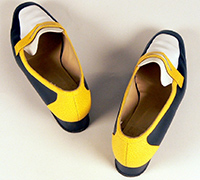 Pair of navy, yellow and white shoes belonging to Jackie Huggins.