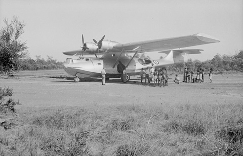 Equipment being unloaded at Milingimbi Island during the 1948 Arnhem Land Expedition.