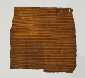 Thin single-layered barkcloth with an orange-ochre colour, decorated with parallel red lines on one side.