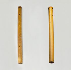 Two nose flutes made from a piece of bamboo cane.