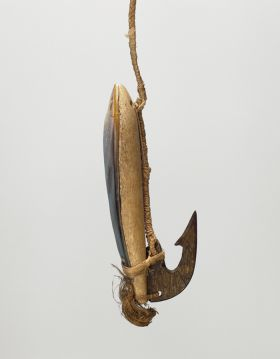 Large fishhook, with wood shank backed with mother-of-pearl and tied together. A barbed tortoiseshell hook also attached to the end.