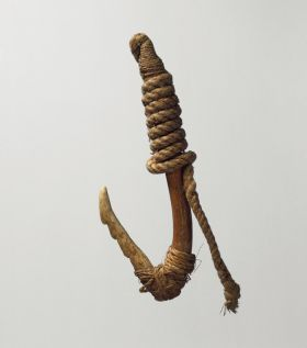 Fishhook with a wooden shank, bone point and lashing of twisted cords of plant material.