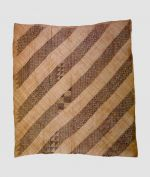 Mat made of dark and light plaited leaf strips interwoven in different ways to form patterns in the dark diagonals.