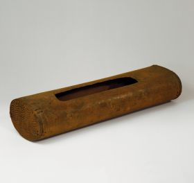 Medium-brown wood box made from a hollowed-out tree trunk with a rectangular opening.